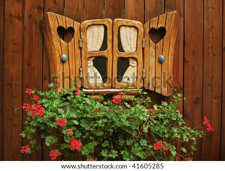 a fantastic window on the background of the wooden walls and colors, - stock photo