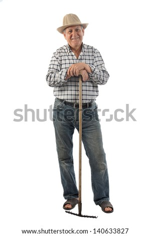 a farmer works with a rake - stock photo