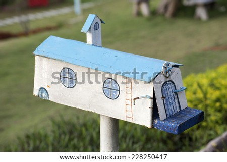 A fashion mail box in front of the house - stock photo