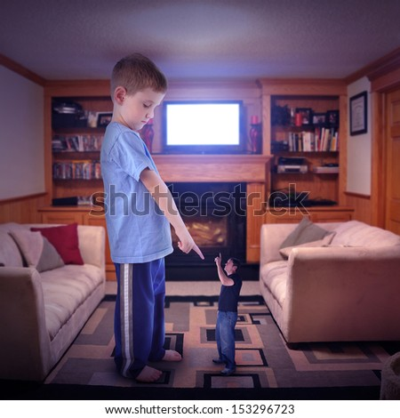 A father and child are in a dispute over the television channel. The boy is pointing at the father who is small for a media control concept. - stock photo