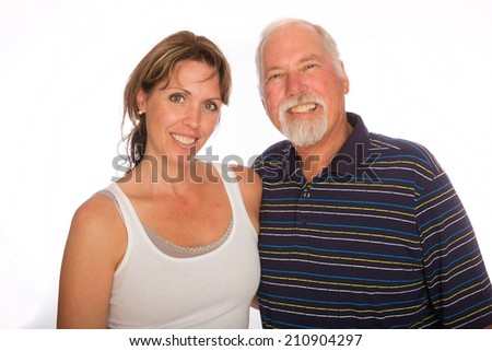 A Father and daughter pose for a photo - stock photo