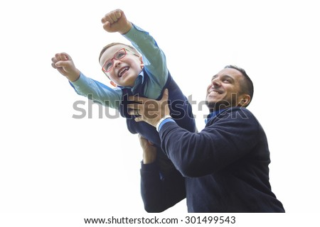 A Father and son in forest on a meadow - stock photo