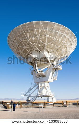 A father and son stand near VLA (Very Large Array) - a group of radio telescopes in New Mexico (USA) - stock photo