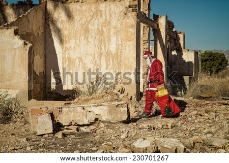A fed up  Santa trudging along with his sack - stock photo
