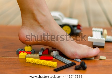 A feet standing up on blocks of various colors - stock photo