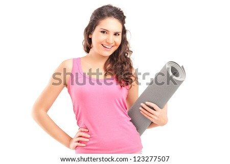 A female athlete holding a mat isolated on white background - stock photo