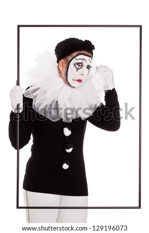 a female clown in a frame is crying - stock photo