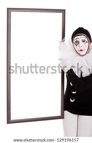 a female clown shows an empty frame - stock photo