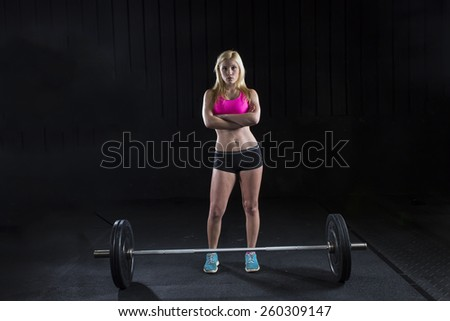 A female college student lifts weights - stock photo