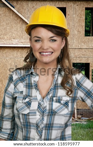 A Female Construction Worker on a job site - stock photo