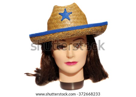 A female Hair Dressers Mannequin Head wears a Cowboy Hat with a Blue Star.  Isolated on white with room for your text. - stock photo