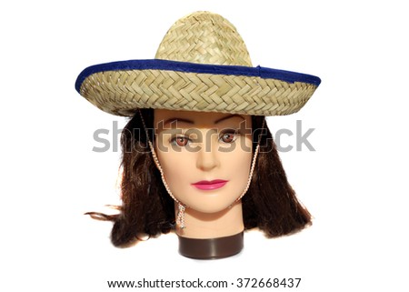 A female Hair Dressers Mannequin Head wears a Mexican Sombrero .  Isolated on white with room for your text. - stock photo