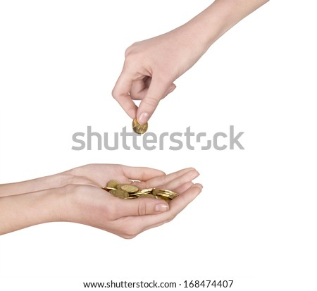 A female hand with coin isolated against a white background - stock photo