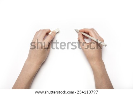 A female hands hold(pick up) grey pencil and eraser isolated white, top view at the studio. - stock photo