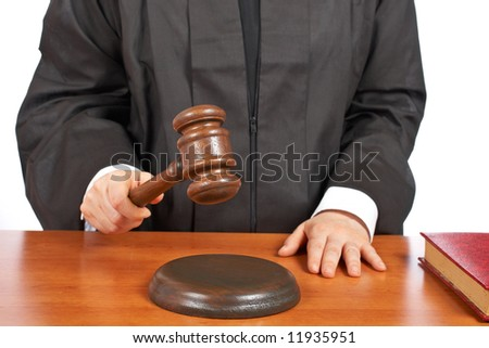 A female judge in a courtroom striking the gavel. Shallow depth of field - stock photo