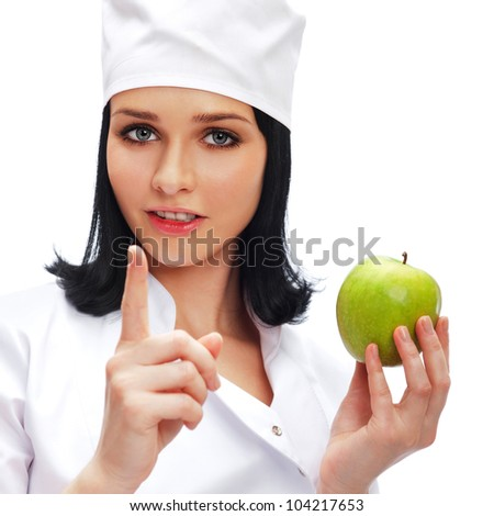 A female medical doctor holding a green apple isolated on white background - stock photo