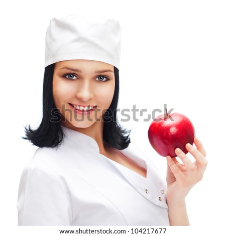 A female medical doctor holding a red apple isolated on white background - stock photo