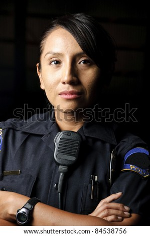 a female police officer posing for her portrait at night. - stock photo