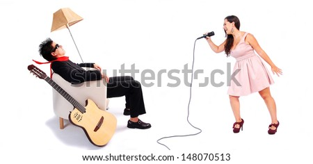 A female singer and a male guitarist in action in white background. The musician is blown away by the powerful voice of the singer - stock photo