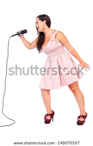 A female singer in action in white background - stock photo
