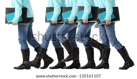 A female student advances toward her goal of graduation for a degree and diploma isolated on white - stock photo