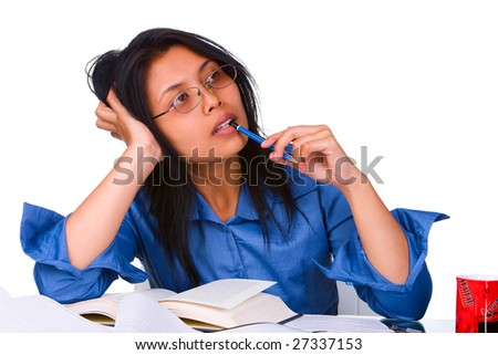 A female student look very tired and not enough sleep still studying for tomorrow examination. - stock photo