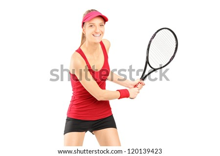 A female tennis player holding a racket isolated on white background - stock photo