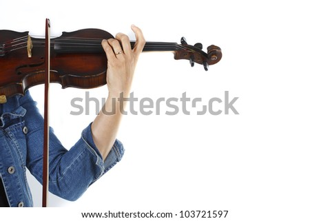 A female violininst wearing jeans, playing the violin, only one hand is shown - isolated on white - stock photo