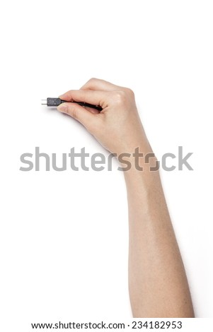 A female(woman) hand hold a black usb cable(jack, plug, socket) isolated white, top view at the studio. - stock photo