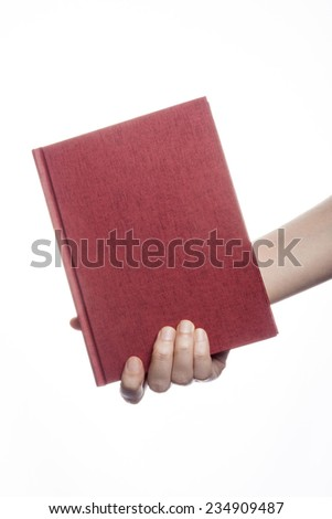 A female(woman) hand hold a empty(blank) book(diary, note) cover isolated white at the studio. - stock photo