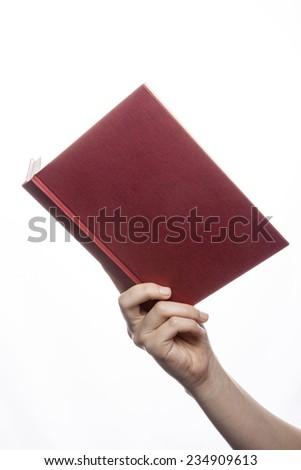 A female(woman) hand hold a empty(blank) book(diary, note) cover spread isolated white at the studio. - stock photo