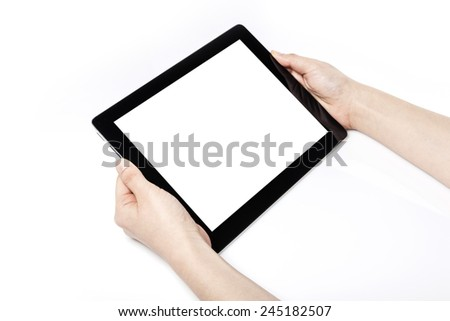 A female(woman) hand hold a empty(blank) tablet pc(pad) isolated white at the studio. - stock photo