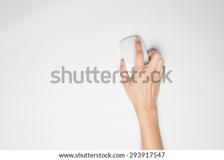 A female(woman) hand hold a mouse isolated white at the studio.on white background - stock photo