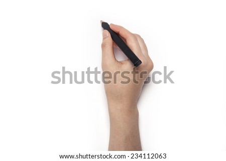 A female(woman) hands hold a black pencil isolated white, top view at the studio. - stock photo
