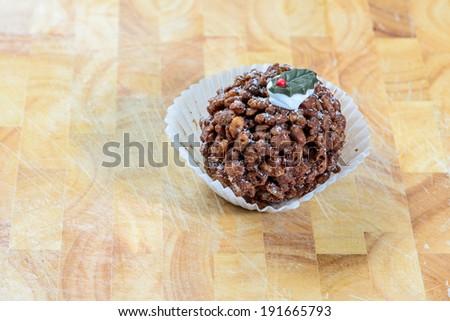 A festive chocolate crispy cake on a wooden background - stock photo