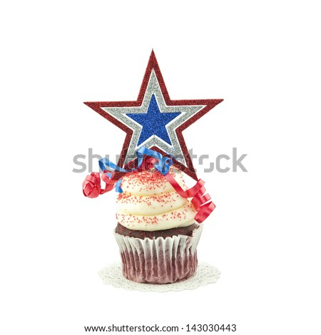 A festive red, white, and blue decorated cupcake, with a star on top, isolated on a white square cropped background. - stock photo