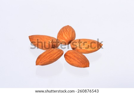 A few almonds scattered on the surface.  - stock photo