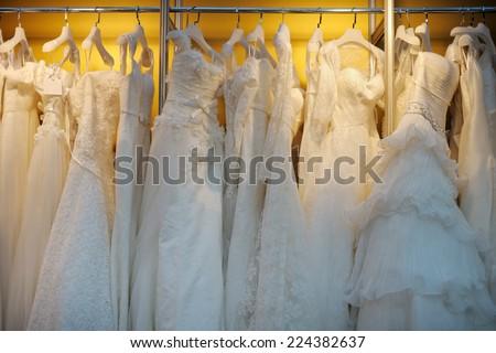 A few beautiful wedding dresses on a hanger  - stock photo