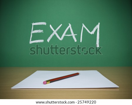 A few blank sheets ready for been filled in a exam. - stock photo