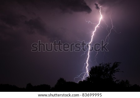 A few elevated thunderstorms put down a few nice bolts of lightning on August 29, 2011. - stock photo