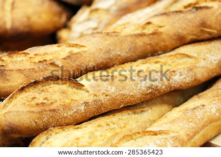 A few fresh baked baguettes. Selective focus. - stock photo
