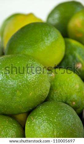 A few fresh green limes. - stock photo