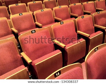 A few rows of empty theater seats - stock photo