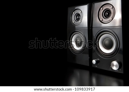 A few speakers on a black background. - stock photo