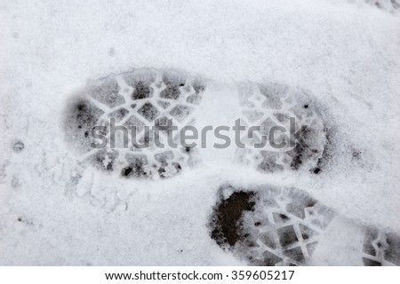 A few traces of man on the thin snow. - stock photo