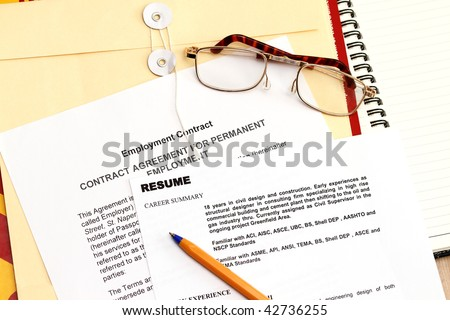 A fictitious resume with employment contract and envelope. - stock photo