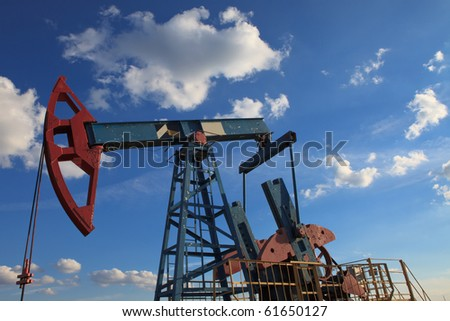 A field pump under the cloud - stock photo