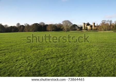 a field with Malahide Castle - stock photo