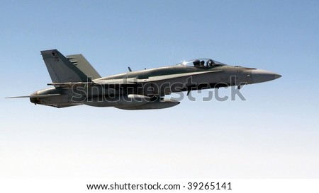 A fighter jet flies through the sky. - stock photo