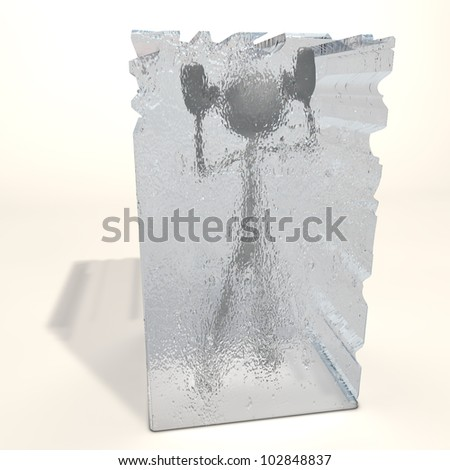 a figure is frozen in an ice cube - stock photo